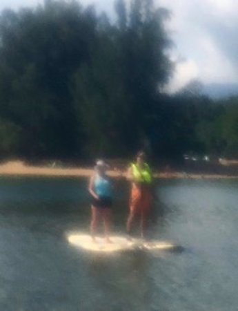 Kilauea, HI: My husband and I, with paddles crossed (apologies for the plastic over the camera, making it a b