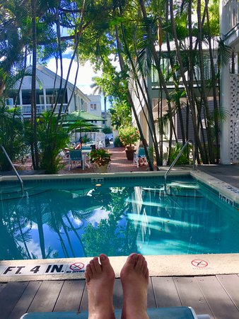 Ambrosia Key West Tropical Lodging: One of two pools at Ambrosia with courtyard beyond. (My satisfied feet!)