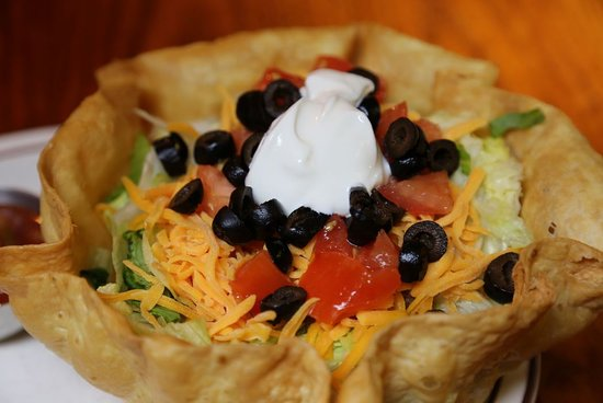 DeWitt, IA: Taco salad served in a tortilla shell.