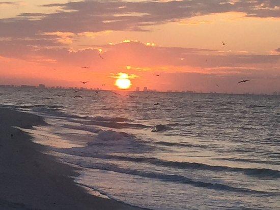 Ocean's Reach Condominiums: Sunrise over Ft. Myers as viewed from Oceans Reach beach