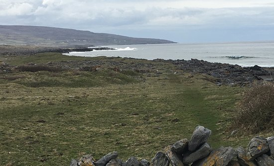Fanore, Ireland: Dry stone walls and grazing land next to the sea