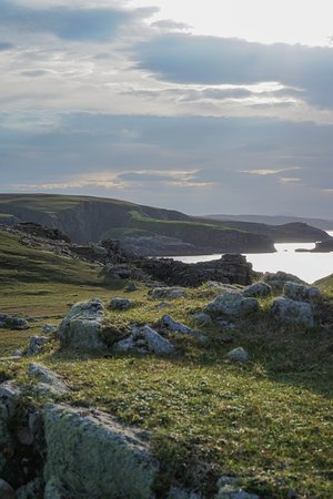 The nearby Strathy Point