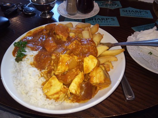 Monyash, UK: Chicken curry with half chips and half rice. HUGE!!