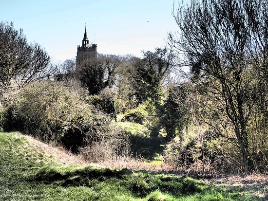 Burwell, UK: Burrell castle with church in the background 