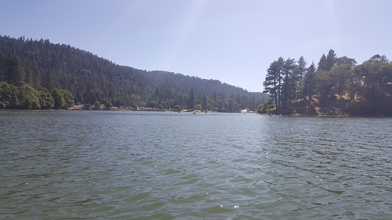 Crestline, CA: Lake Gregory hidden in the pines on a warm sunny day.