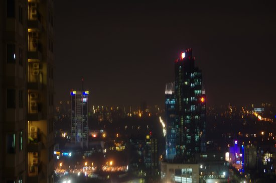Thamrin Residence Condotel: Night view from balcony.