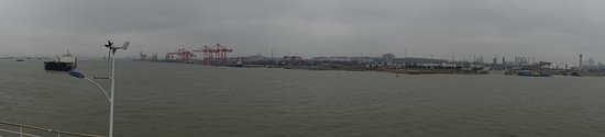 Taixing, China: Panorama from our cabin. Another day, another port.