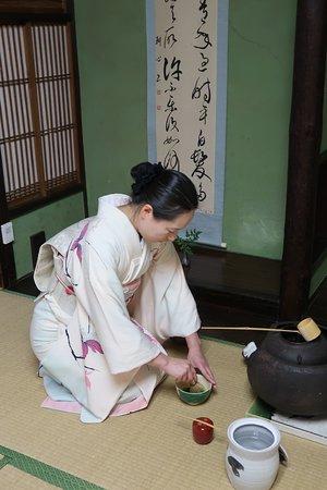 Green Rose Calligraphy: The tea master preparing matcha