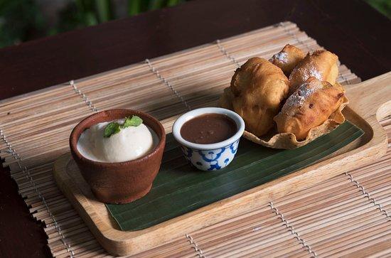 Banana fritters. chocolate sauce, vanilla ice cream