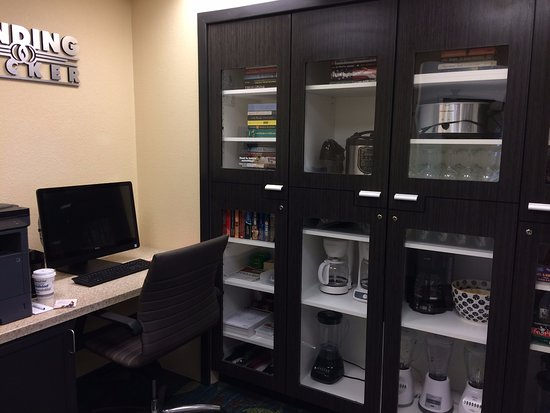Candlewood Suites Yuma: Cupboard (appliances, games, puzzles) and a parial of the business center