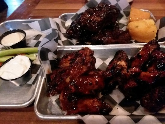 Hot Asian & Strawberry Jalepeno Wings (bottom), Chocolate BBQ ribs (top)