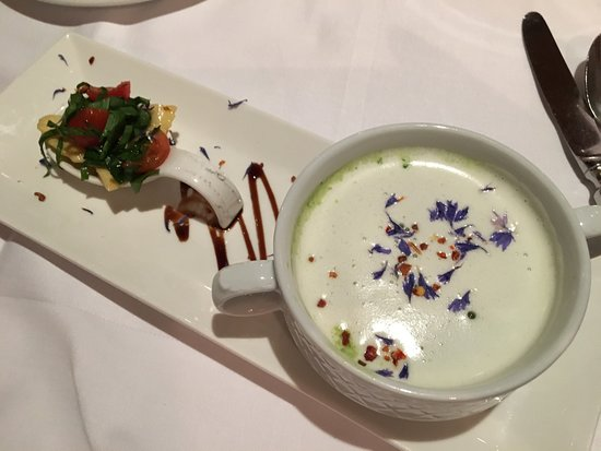 Vitznau, Switzerland: Cream of Wild Garlic Soup with Spring Petals and a Vegetable Bouquet. Stunning!!