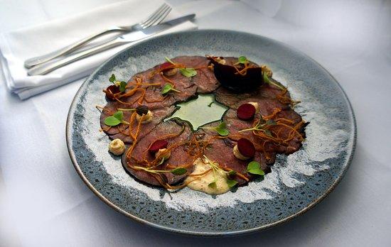 Copacabana, Αυστραλία: Carpaccio of Beef Fillet, Fried Enoki, Juniper Creme, Amaranth