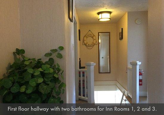 Casco, ME: First floor hallway: 3 rooms, 2 bathrooms.