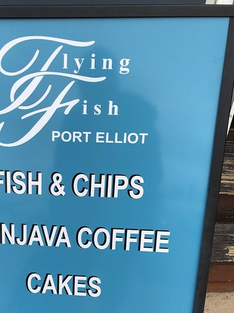 The Flying Fish Cafe: The enticing advertisement on the front door.