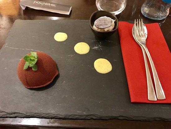 KOBE Steak Grill Sushi Restaurant Václavské nám.: Light and dark nougat caramel dessert with pistachio sauce and vanilla ice cream