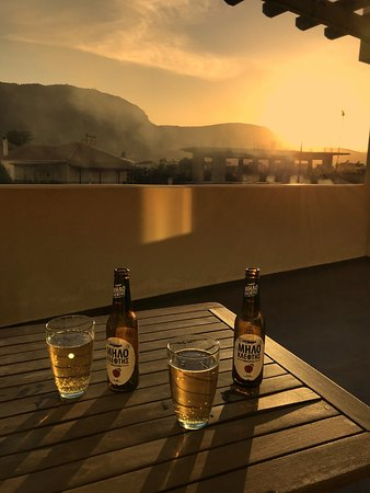 Diakofto, Yunani: Enjoying the sunset on our own terrace