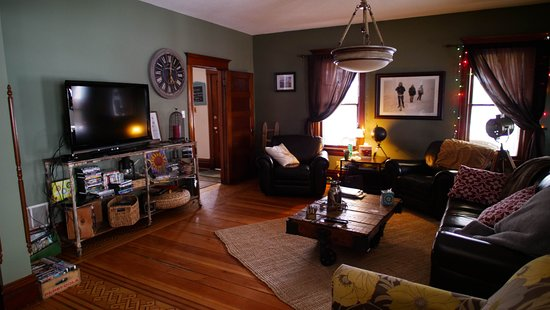 The cozy living room area with a large flat screen TV ...