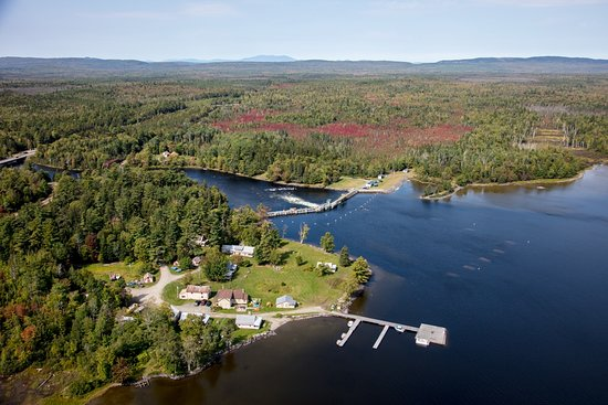 Greenville, ME: Aerial view of the cabins in the fall, our dock system, Moosehead Lake, and the river headwaters