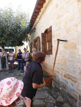Anogyra, قبرص: Working the carob traditionally.
