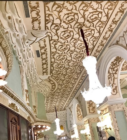 Chandeliers on ornate ceiling