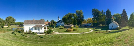 Sioux Falls, SD: View of the historic buildings at Augustana Heritage park include a church, house, school and ca