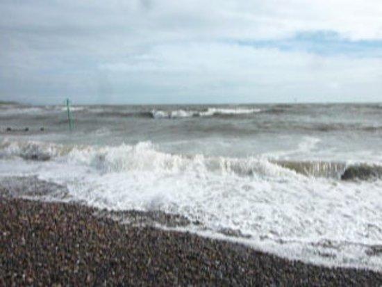 St Bees, UK: Waves crashing onto the pebbles.