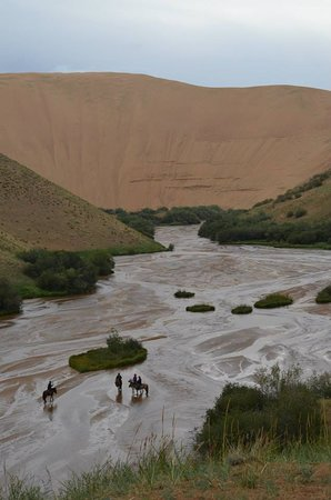 Big Mongolia Travel : Horseback riding at a desert oasis.