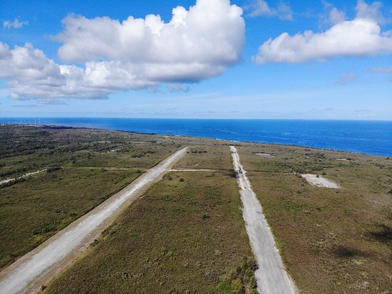 view from drone over Tinian airfield. Runways Able, Baker below.