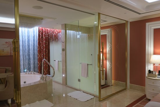 okada manila hotel bathroom toilet shower in glass enclosures - Glass Enclosures