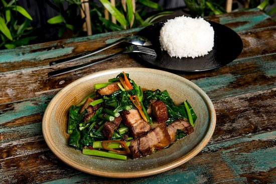 CRISPY PORK STIR-FRY AND RICE Chinese Broccoli in oyster sauce and