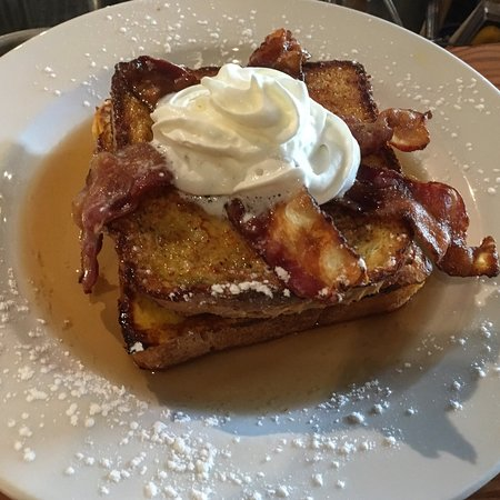 Pender Island, Canadá: Maple whiskey syrup glazed Texas cut French toast with bacon and whipped cream.