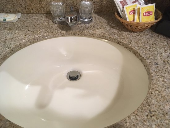 Durand, MI: Upgraded counter, but to use the faucet you bump up against the edge of the sink.