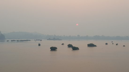 Don Khong, Laos: Sunrise on Mekong River from room patio.
