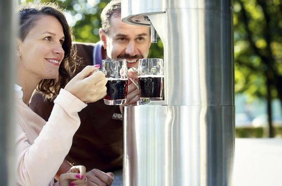 Cheers with beers at beer fountain in...