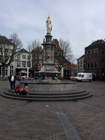 "Deventer, The Netherlands: The ""Wilhelminafontein"" on the Brink, with some locals resting on the steps"