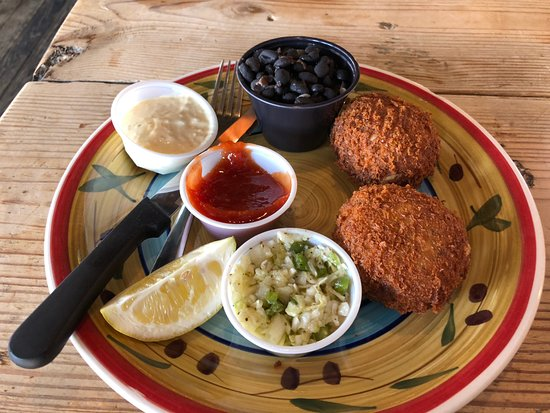 Crab cakes with cole slaw and black beans rice picture for Big fish seafood bistro