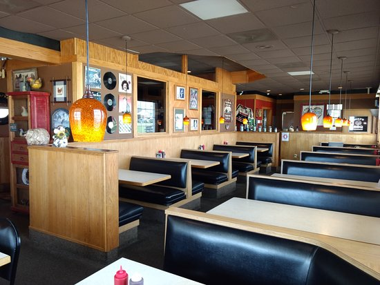 Nevada, MO: Comfortable and cozy booths with over-the-table lighting invite you right in.