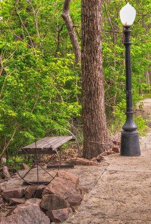 Medicine Park, OK: Shady path along Bath Lake on the riverwalk