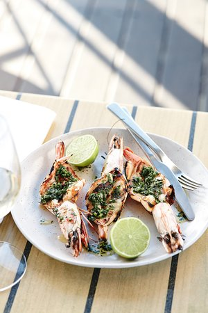 Grilled Skull Island tiger prawns, herb butter  - Picture of