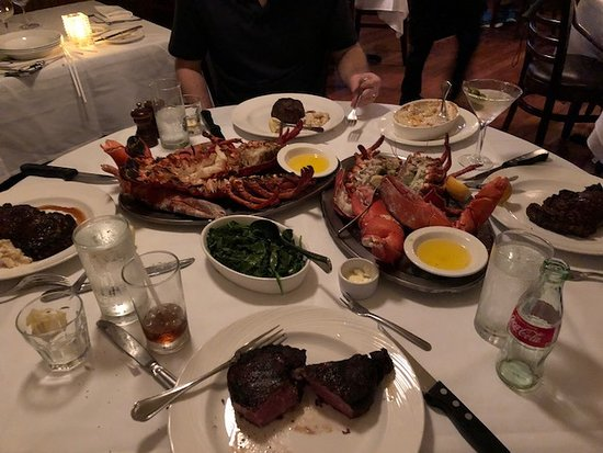 Bay Harbor Islands, FL: A perfect table for 4 with 4 steaks and two 3 pound lobsters