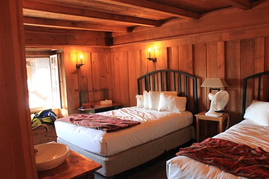 Old Faithful Inn: One of two rooms in a family suite.