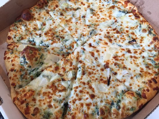 Manchester, ME: Fresh pizzas made to your specifications or grab a slice to go from the wheel.