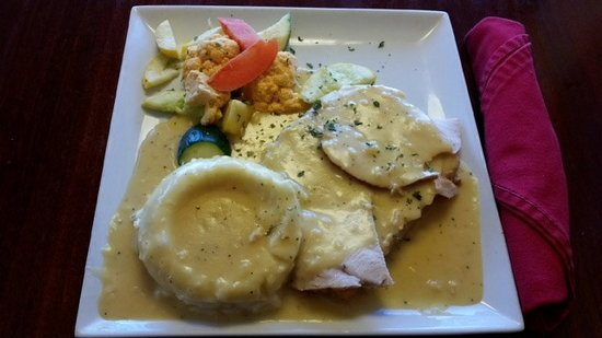 Innsider Bar and Grill: Carved Turkey Served Open-Faced on Sourdough with Mashed Taters