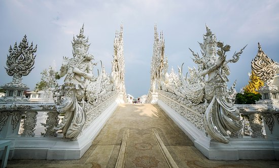 Wat Rong Khun: ...and when you look back, serene images of heavenly maidens