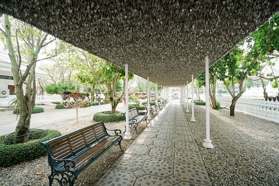 Wat Rong Khun: A seating area that doubles as the walkway that contains all those tourist names on their own le