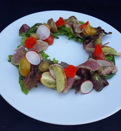 Tuna Nicoise, seared fresh tuna loin baby potatoes, snake bean, radish, cherry tomatoes.