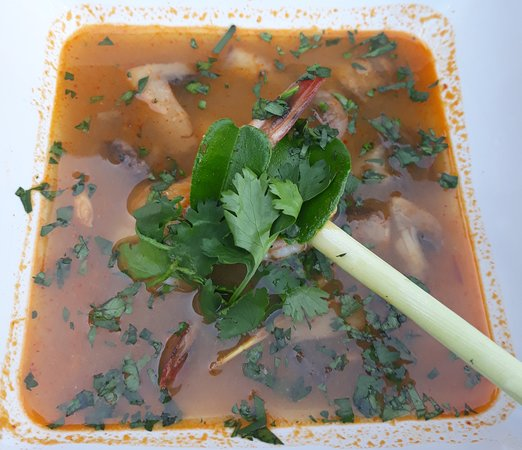 Tom Yam Gong, hot & sour tiger prawn broth, with mushroom, lime, lemon grass, chili and coriande
