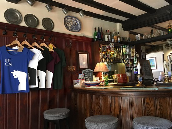 West Hoathly, UK : Bar area and souvenir T-shirts at The Cat