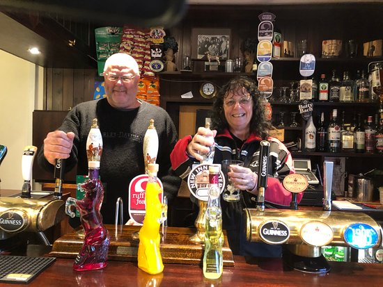 Fownhope, UK: Bar owner let us take a photo behind the bar. Lovely lady.